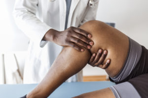 Sports Medicine Doctor consulting with patient Knee problems